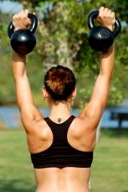 Corsi Fitness di Kettlebell in palestra esercizi per addominali, braccia, spalle, gambe e glutei